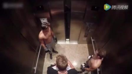 肌肉男电梯内打拳击 美女被惊吓瞬间花容失色