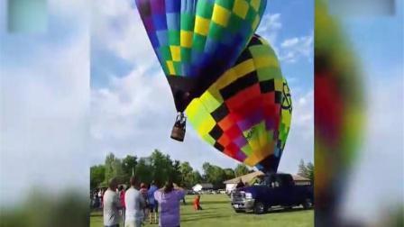 实拍两热气球空中相撞  乘客掉出摔下地面