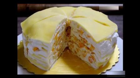 芒果千层蛋糕教程, 满满的都是芒果香甜的奶油和芒果丁夹在一层又一层薄薄的蛋饼中。