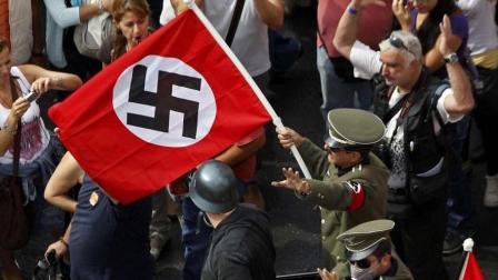 希特勒是如何成为元首并将纳粹礼带入历史舞台的?