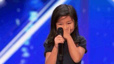 香港九岁女孩谭芷昀远征美国真人秀 小小年纪歌声却震撼全场