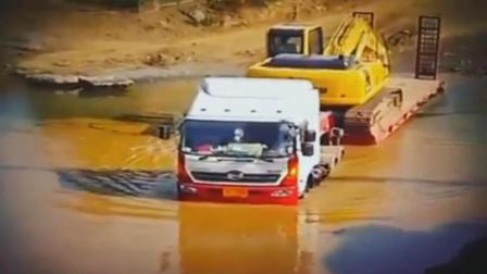 奔驰大货车带上挖土机就往河里开去, 你以为他疯了? 他一天跑好几趟