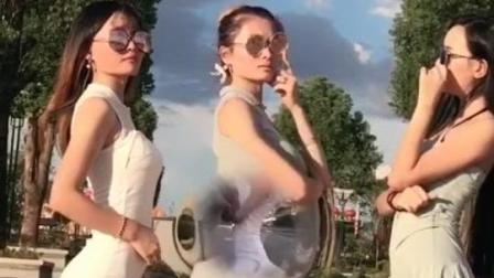 三个美女马路上街拍 包臀裙一个比一个性感