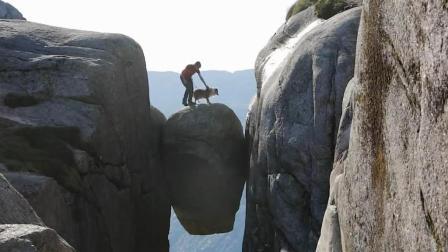 全球最神奇的石头: 卡在悬崖中间离地1000米, 多大胆才敢上去?