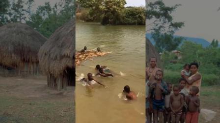 非洲游记: 贫民窟一群黑人小男孩腰上绑着饮料瓶, 在小河流里激流勇进