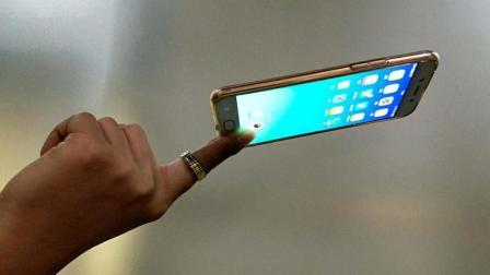 颠覆物理定律的魔术: 一个手指也可以托起一部手机, 其实特简单