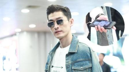 张翰潮装现身星范儿十足 手机背景竟是他自己