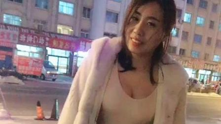街拍: 身材丰满的少妇, 就算天再冷也要风度不要
