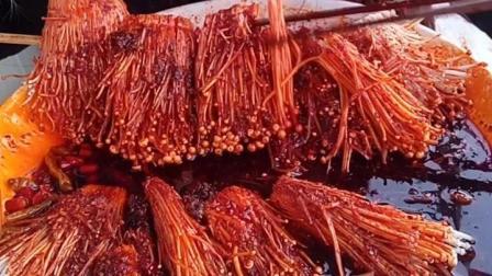 吃红油生金针菇的见过吗? 脸已皱成一团