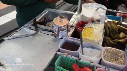 印尼特有街头小吃 旋转烤蛋皮裹巧克力面包片做法和味道都很奇特!