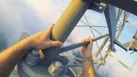 狂人攀爬564米高铁塔 顶部一跃而下空翻转体