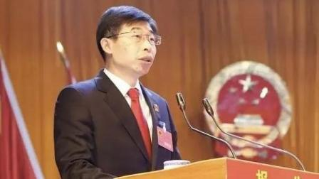 正安县人民法院院长田细江在正安县会上汇报《猎赖风暴》成果