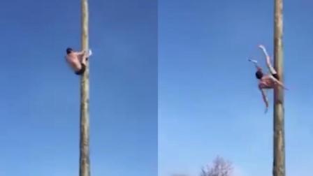 男子雪天表演爬杆失手 高空中坠落重摔在地