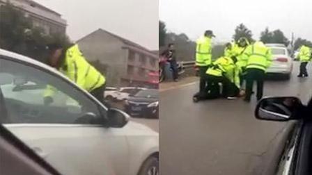 无牌小车逆行抢道拒查 顶行交警数百米被抓