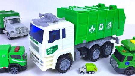 造型不同的垃圾车清理路面上的纸屑垃圾
