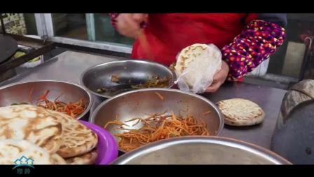 外国美女来宁夏吃早餐, 熟练用微信买了一个烤红薯, 中国移动支付太方便