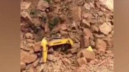挖掘机工作有多危险, 看这个石头掉下去瞬间!