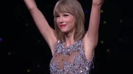 泰勒演唱会突现科比! 两人站在一起泰勒看起来和科比差不多高!