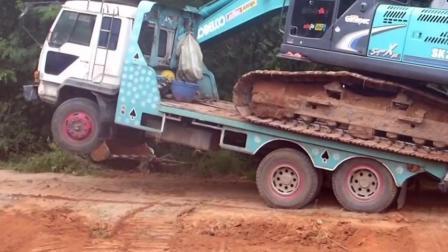 看看挖掘机是如何上车的? 卡车表示hold不住