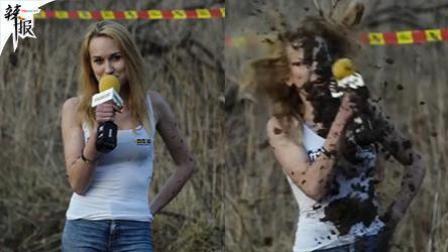 美女采访赛车手 突然被溅一身泥