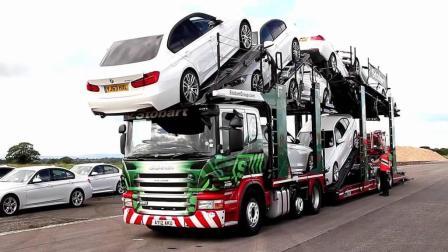 宝马车层层叠放, 场面如同车祸现场, 老外却说这样运输最安全!
