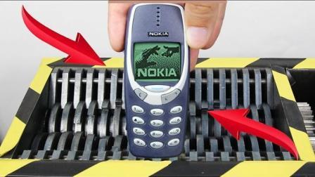 小伙把珍藏十年的6台诺基亚扔进粉碎机, 网友: 不愧是砖头手机!