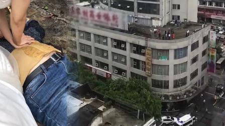 拍婚纱照时遇坠楼事件 女子迅速投入紧急抢救