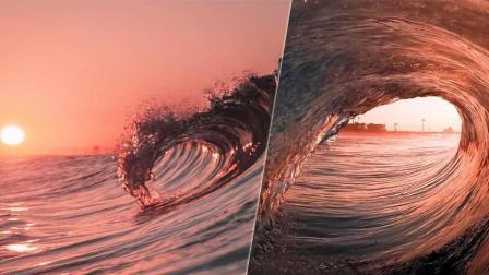难得一见! 冲浪牛人捕捉海浪内部美景 落日余晖映衬如诗如画