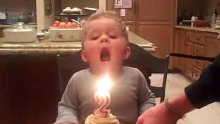 嗅君葩闻 美国男童生日蜡烛吹不灭 着急吃蛋糕模样呆萌