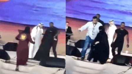 女粉丝冲上舞台拥抱男歌星 可能会蹲两年大牢