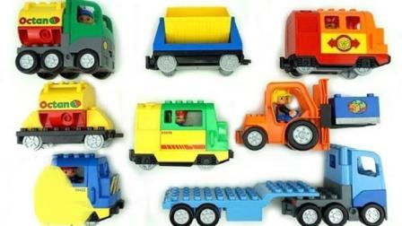 组装小卡车运输货物在轨道上行驶