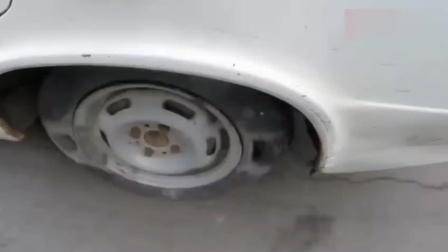 牛人在汽车轮胎灌入水泥, 到路上开一圈回来后