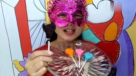 美女吃雪花棒棒糖形状的巧克力, 用巧克力做的棒棒糖, 超好吃!