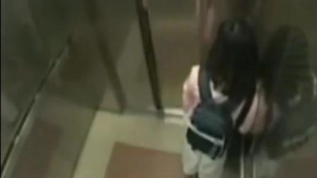 女子正在坐电梯, 突然进来一个男子, 监控拍下女子霸气的一幕