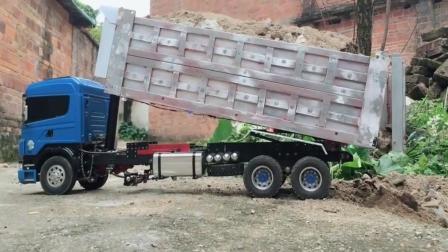 玩具车: 大货车升顶卸货 这大货车是不是少轮胎?