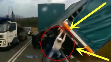 大货车路边发生侧翻, 男子竟徒手将车扶正了, 还真是敢想敢做啊