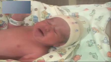 这宝宝是刚从产房里抱出来的, 脐带还是刚刚剪断