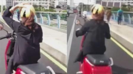 女子骑电动车竟用柚子皮当头盔 只为躲避罚款
