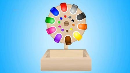 玩积木转盘玩具得到彩色足球
