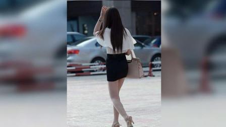短裙美女站在路边等人, 谁知身后男子如此举动, 监控拍下全程!