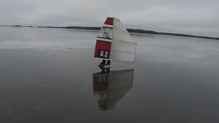 世界最快的滑冰速度, 人身上套个风帆, 时速112公