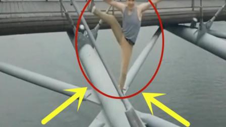 男子站在高架桥上做引体平衡,监控拍下了悲惨的瞬间