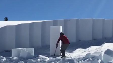 美国黄石公园积雪高达2米 工人铲雪像在运冰箱