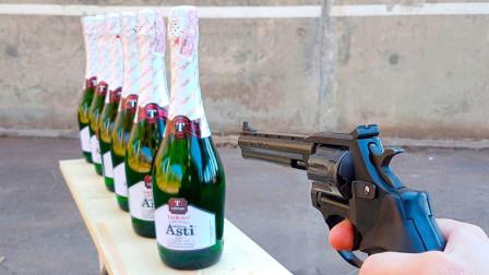 左轮手枪的威力到底有多大?老外用6瓶香槟测试,真是大开眼界啊