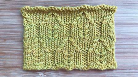 错落有致的叶子花,简洁大气,织长款开衫很漂亮编织花样图