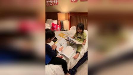 大家新年好 兄妹俩在看绘本, 哥哥认真研究图片