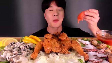 大叔吃大只炸鸡,搭配八爪鱼、生蚝和扇贝肉,还有三文鱼片