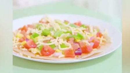 一张手抓饼做一个披萨,那叫一个酥脆,简直太美味了!