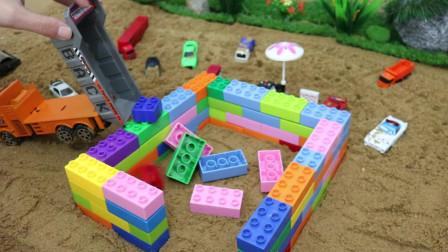 用积木在下雨天给汽车们建一个车库