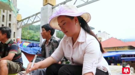 越南街头卖烤玉米的苗族农村姑娘